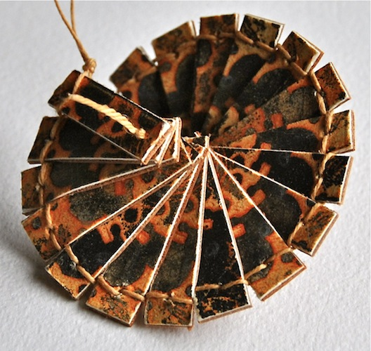 Helix, 2013. Artist's book using a palm leaf structure. Etching, leather and linen thread. Book art by Louisa Boyd.