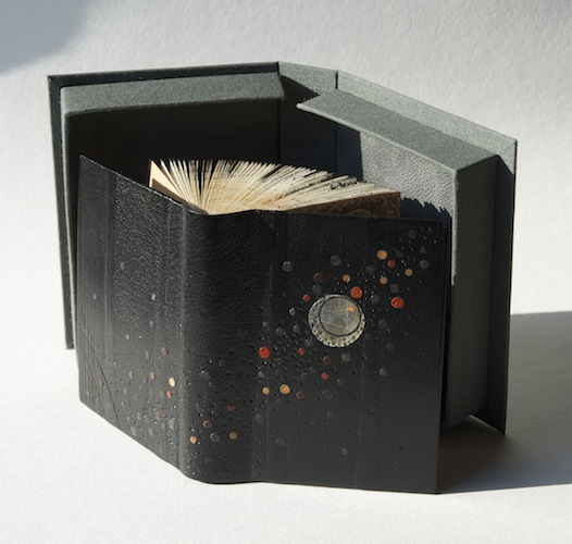 Aether, 2013. Leather hand bound artist's book with box. Cover in leather and paper onlay. Book art by Louisa Boyd.