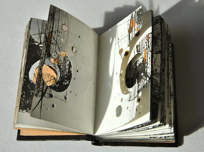 Aether, 2013. Leather hand bound artist's book. Detail of cut and printed internal page. Book art by Louisa Boyd